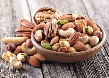Nuts mix in a wooden plate